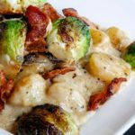 One of the best gnocchi dishes you'll ever have! Tender potato gnocchi in a bacon cream sauce, crispy bacon and roasted Brussels Sprouts.