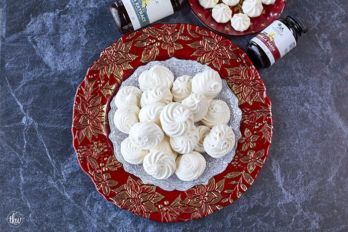 These French Vanilla Meringue Sandwich Cookies with Ganache filling are cloud-like treats that melt in your mouth with a slightly crisp outer shell, a slightly chewy center, and a decadent chocolate ganache filling.